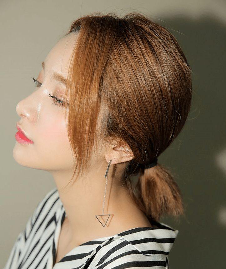 tóc ngang vai cột đuôi thấp