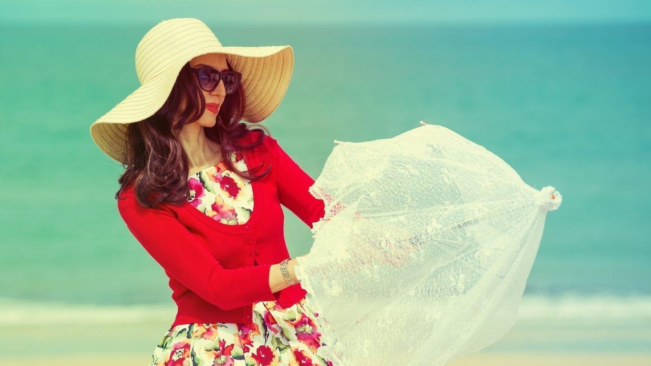 Nón và dù là cách dưỡng trắng da toàn thân trong 1 tuần