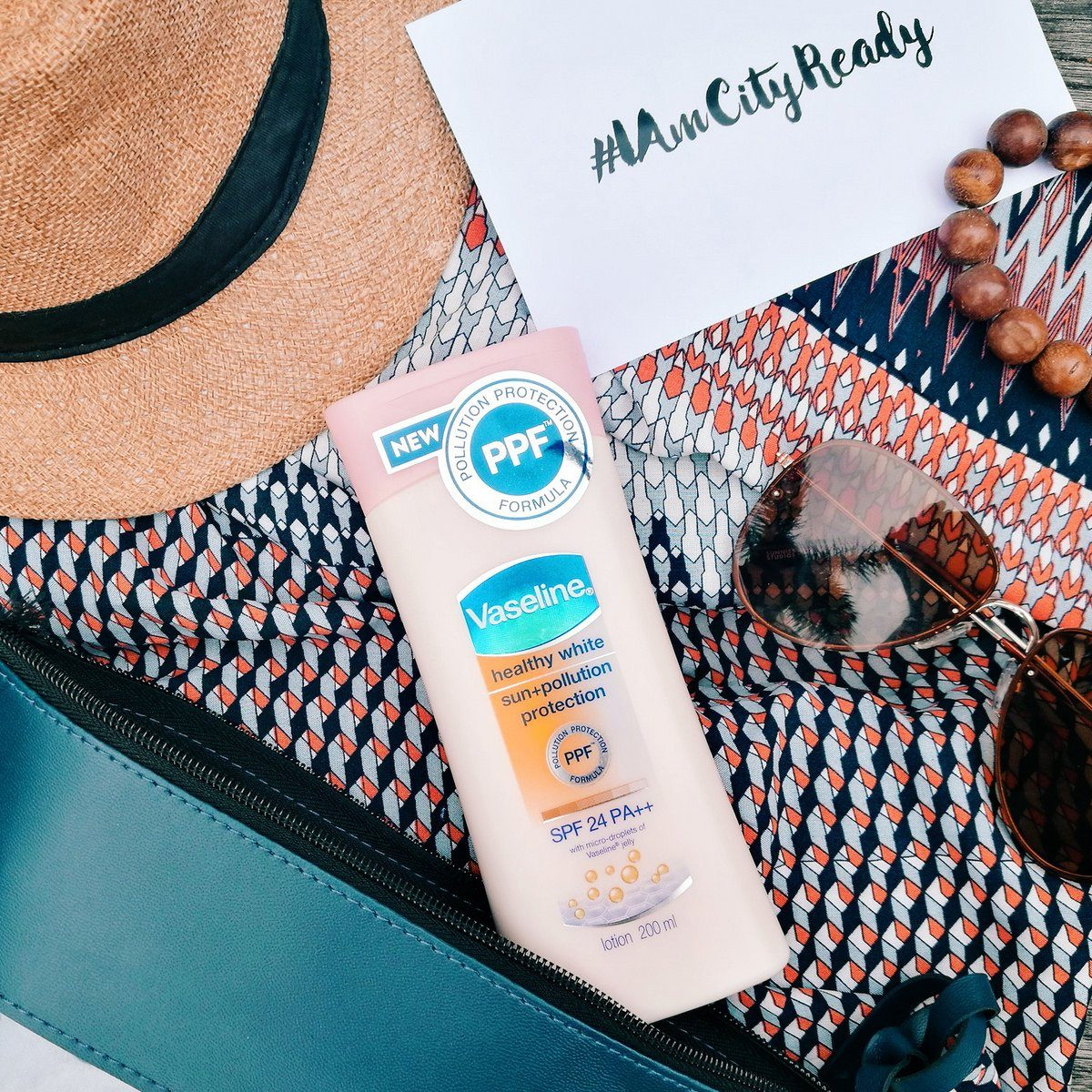 kem dưỡng thể Vaseline anti-pollution 3-in-1 Healthy White Sun and Pollution Protection SPF 24 PA++