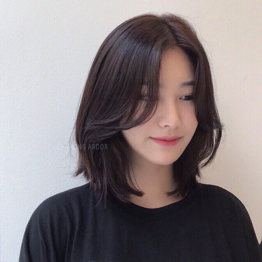 tóc uốn cụp đuôi