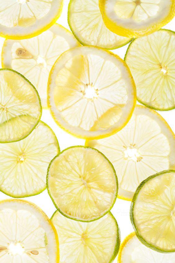 Citrus slices fresh fruit background by Olha Klein on Creative Market