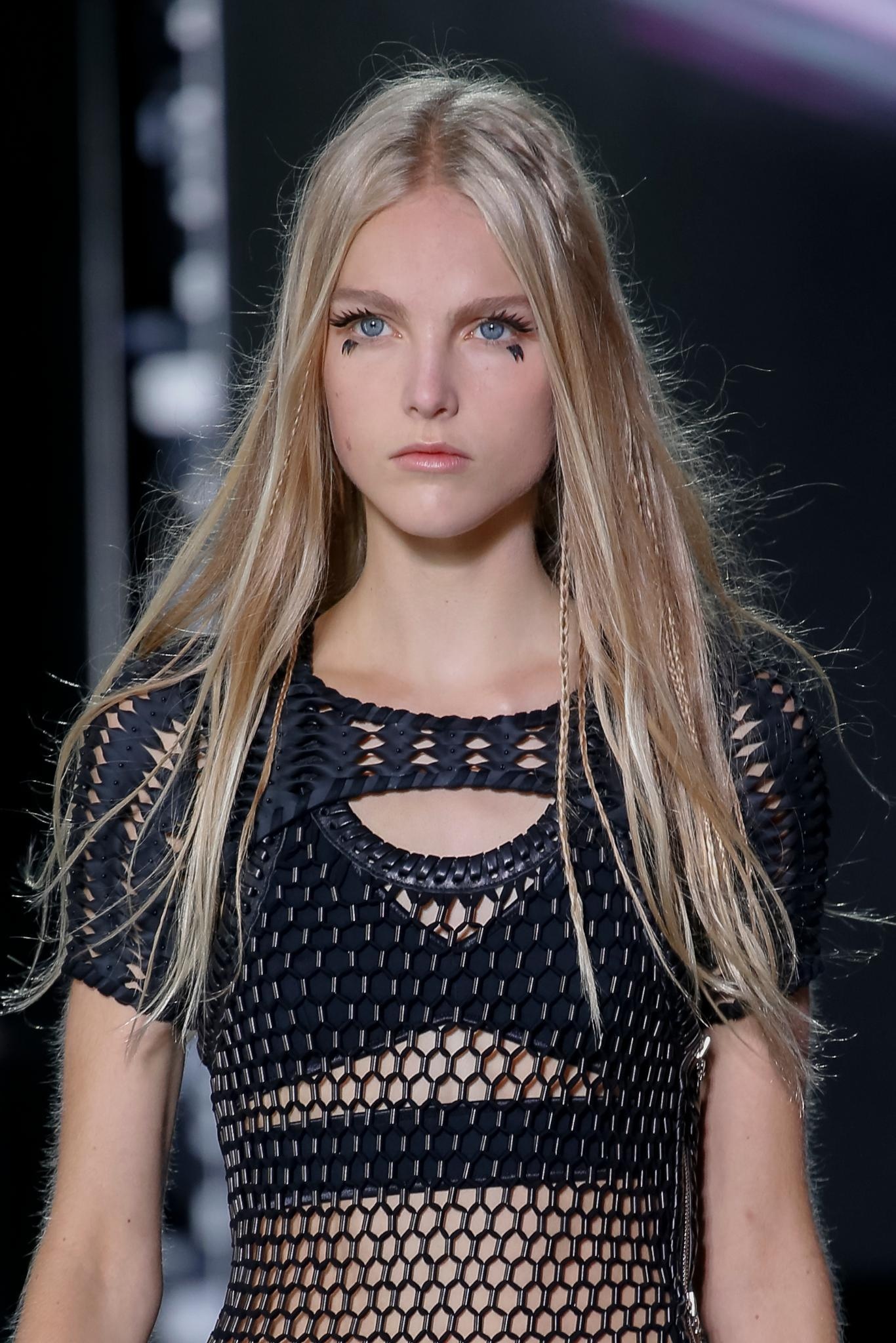 Vintage hairstyles: Blonde runway model with long straight hair with '70s style hidden braids and natural texture