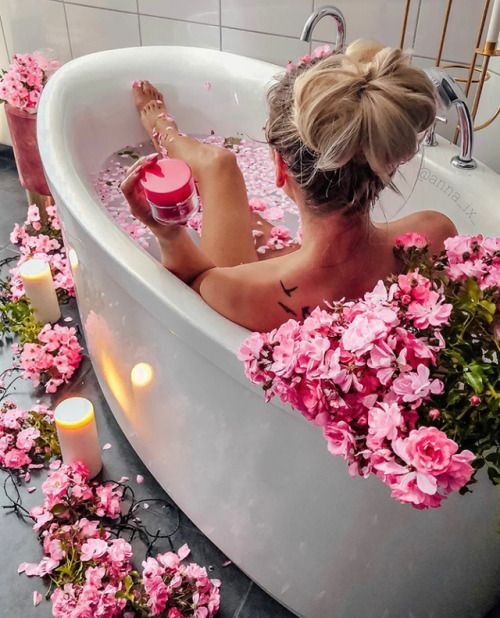 woman. bath. flowers.