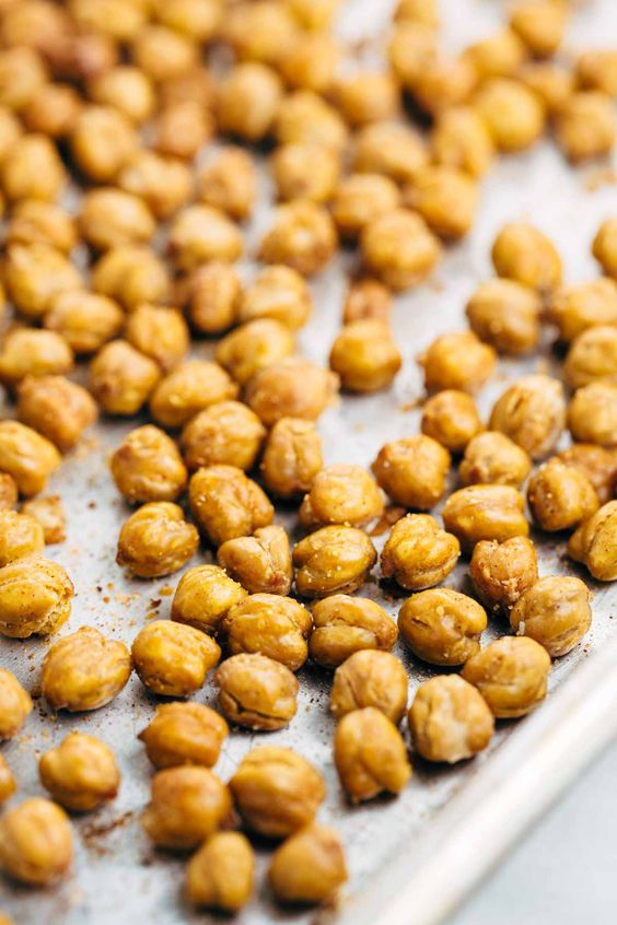 How To Make Crispy Roasted Chickpeas in the Oven - A simple guide for crunchy legumes that are the perfect healthy snack or addition on top of salads and soups. | jessicagavin.com