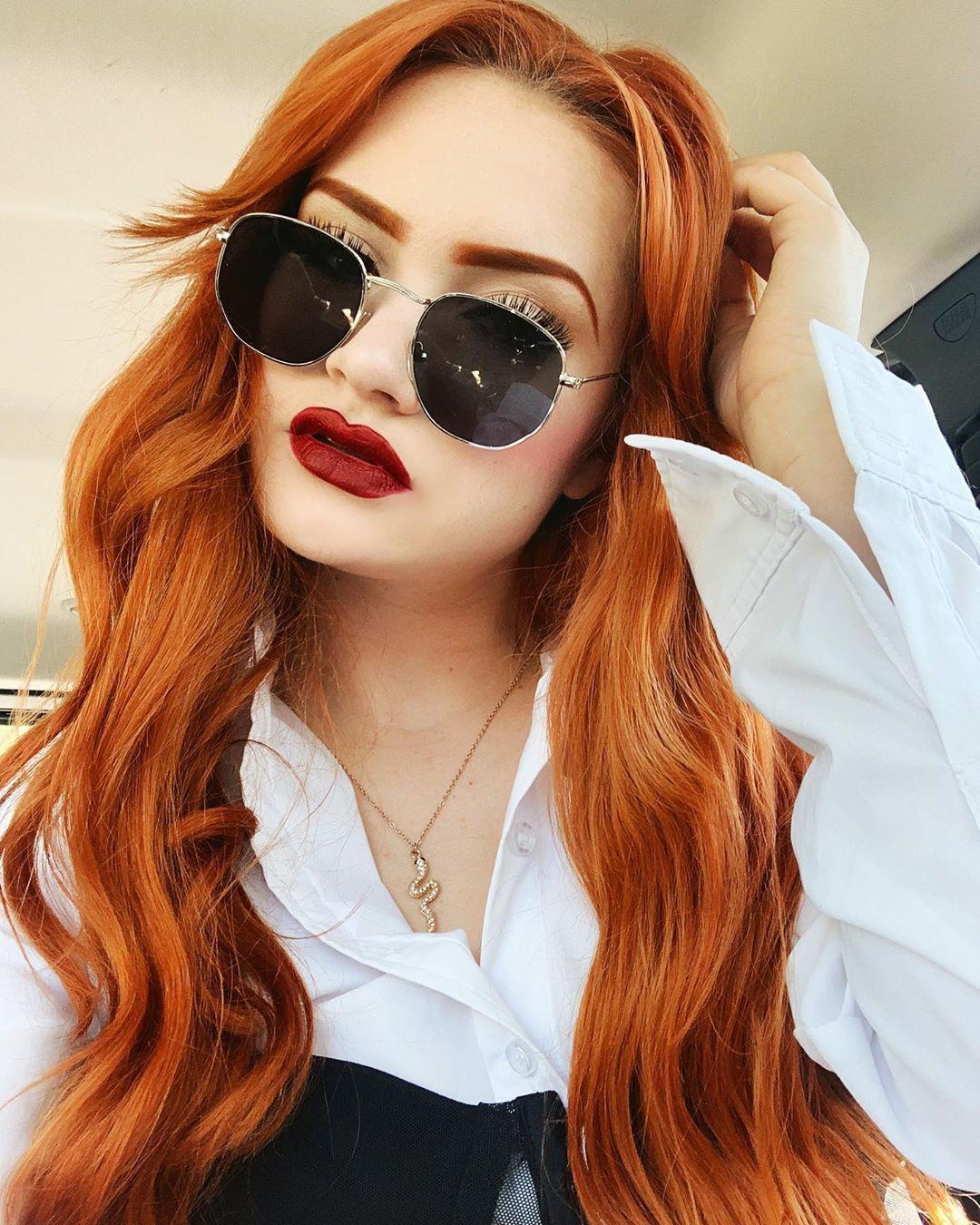 Woman with long, wavy pumpkin spice hair