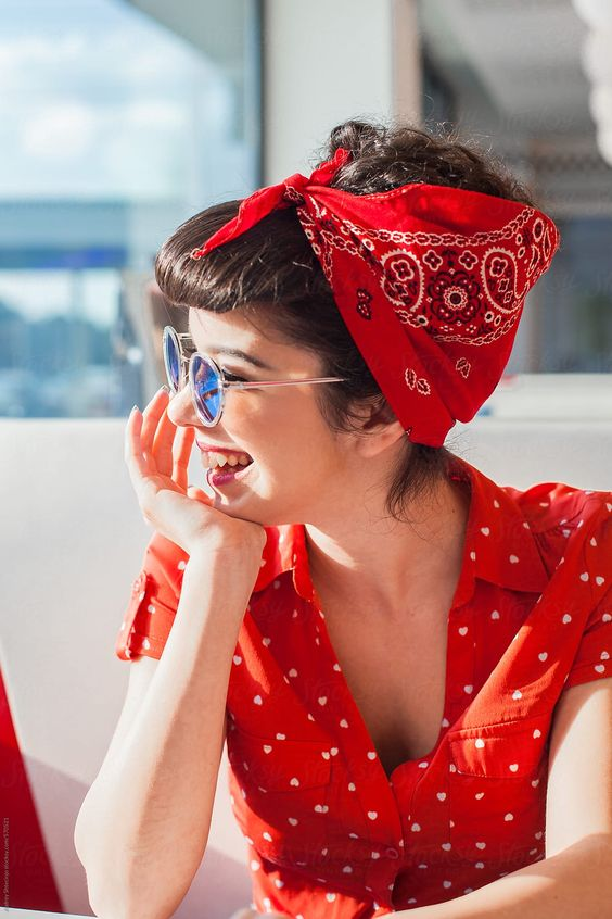 Portrait of young rockabilly girl smiling. by Audrey Shtecinjo for Stocksy United