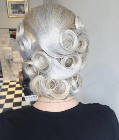 back view of a womans hair with pin curls up do 1950s hairstyles