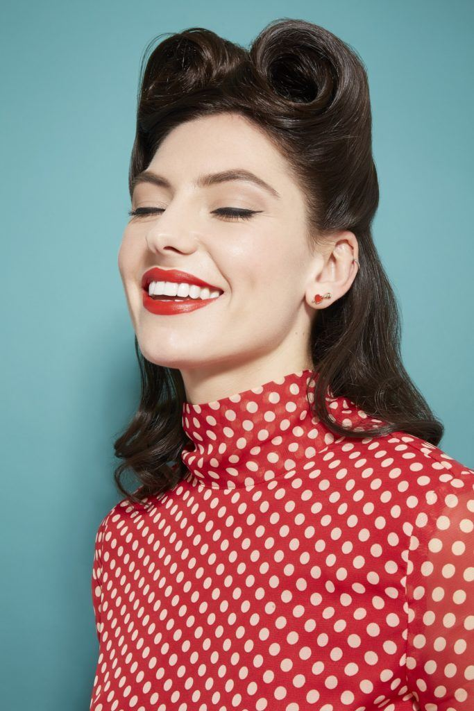 Brunette model with hair in retro victory rolls