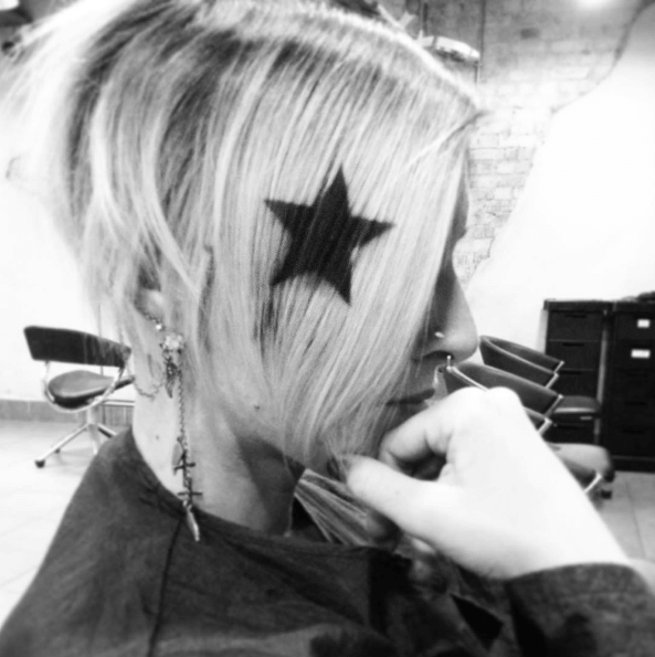Blonde short hair with a black star
