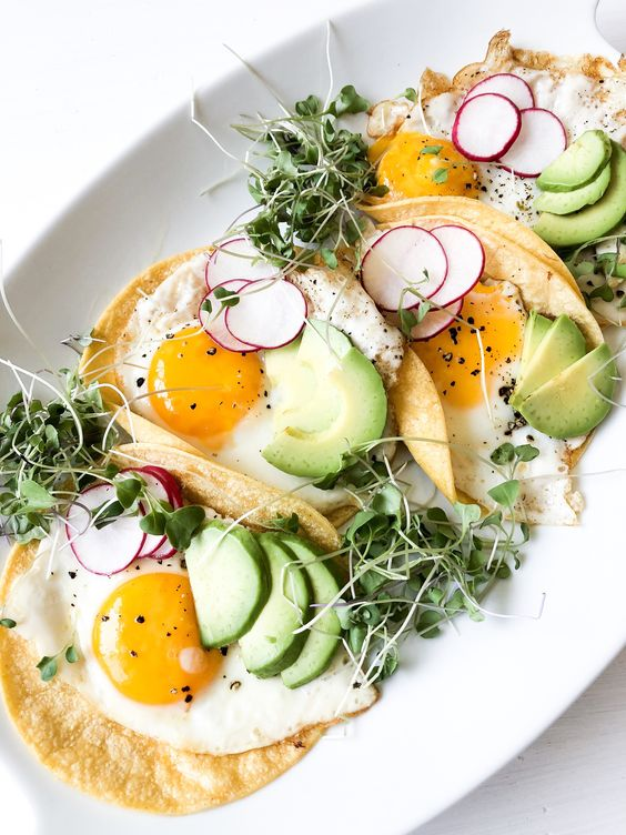 These Vegetarian Breakfast Tacos are loaded with fresh greens, spicy pickled veggies and packed with protein from a sunny side up egg. #vegetarianbreakfasttacos #breakfasttacos #vegetariantacos #salimaskitchen #vegetarian