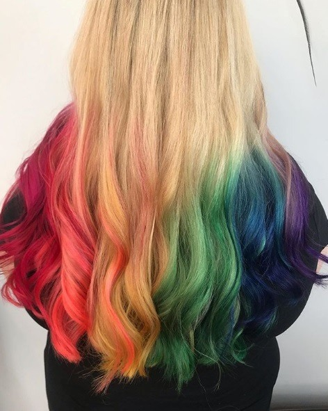 Woman with blonde hair and rainbow ombre