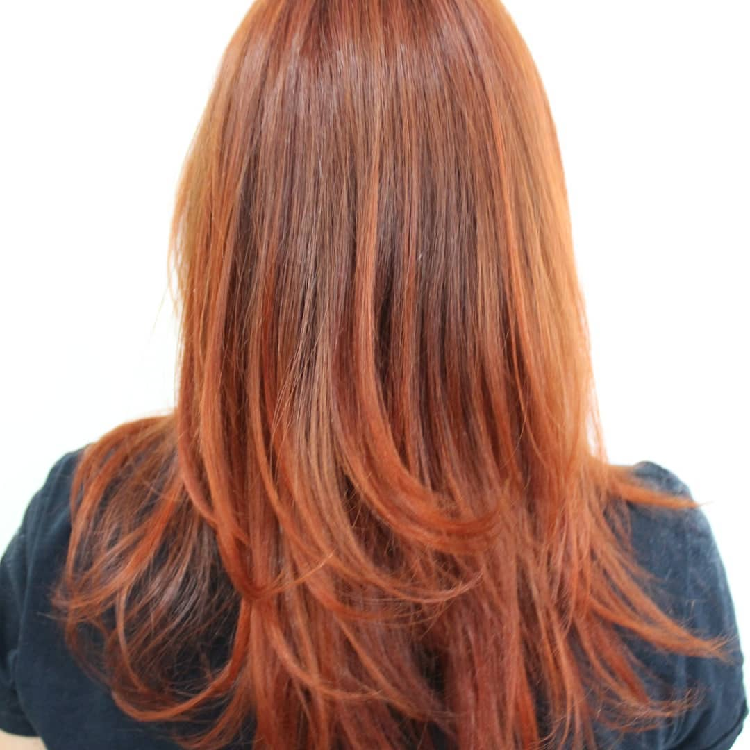 Woman with classic pumpkin spice hair colour