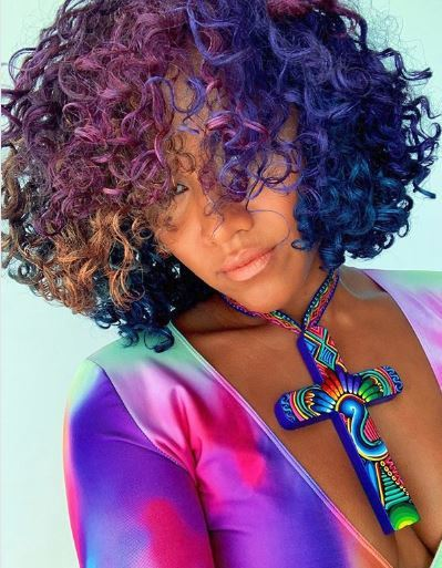 Woman with curly rainbow hair