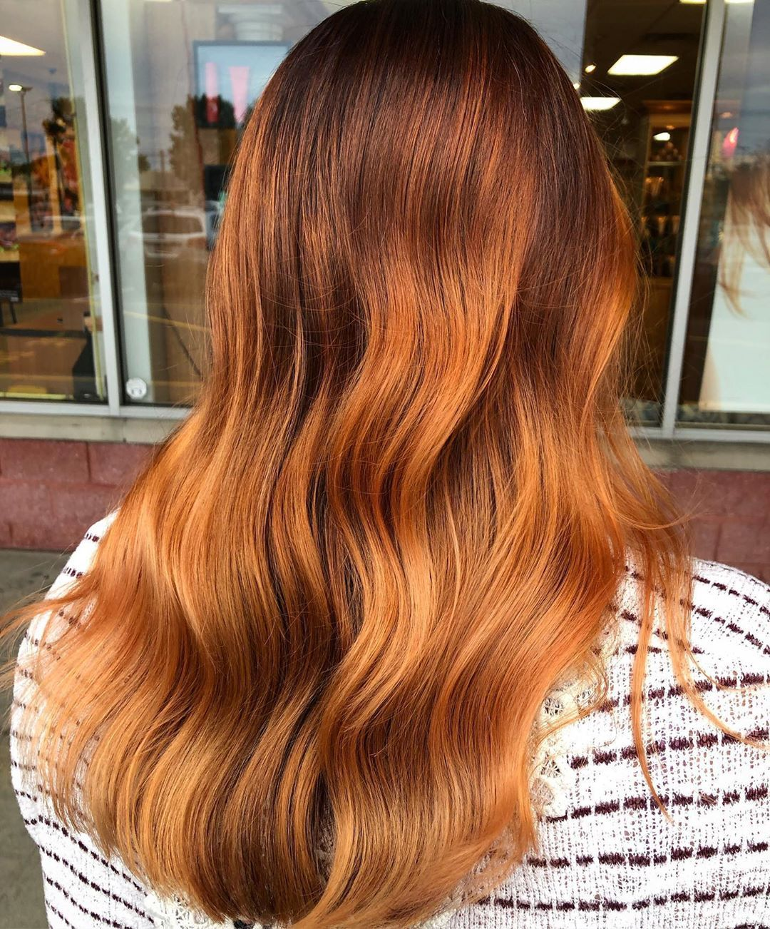 Woman with golden pumpkin spice hair colour
