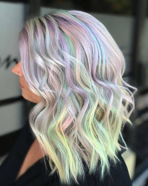Woman with pastel rainbow wavy hair