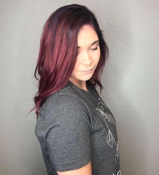 woman with shoulder length red and purple colour melted hair