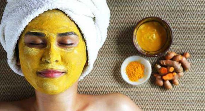 cách làm trắng da từ cam và bột nghệ