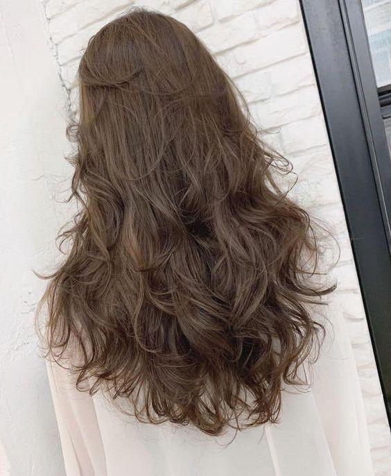 Tóc dài uốn xoăn sóng tự nhiên