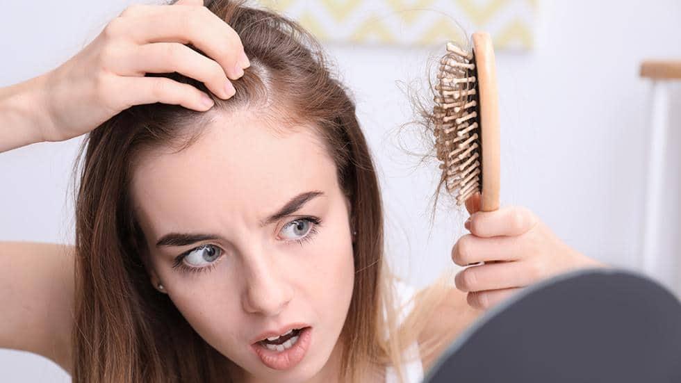 triệu chứng khi rụng tóc hói đầu
