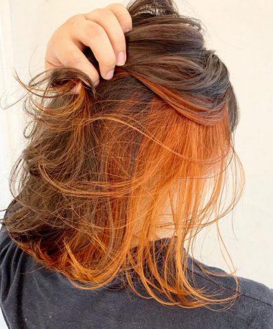 Nhuộm tóc giấu màu cam