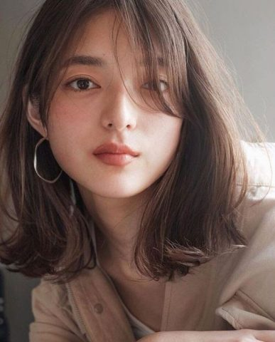 Tóc layer nữ mặt tròn tóc mỏng