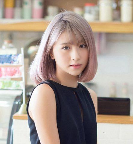 Kiểu tóc uốn cụp ngang vai nhuộm màu