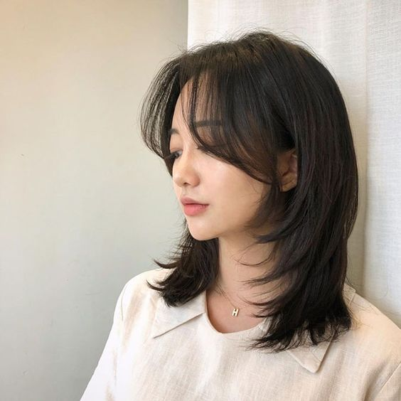 tóc layer nữ mặt tròn có mái